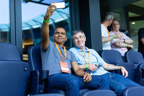 Delegates taking selfies at the SNS Tottenham event