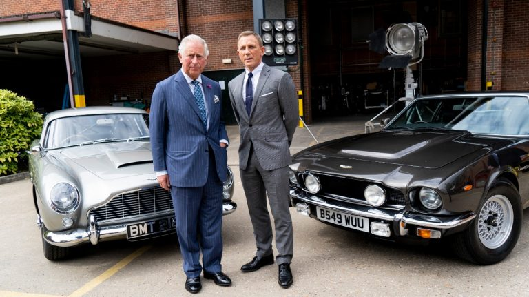 Prince Charles and Daniel Craig with Aston Martins at Pinewood Studios for No Time To Die