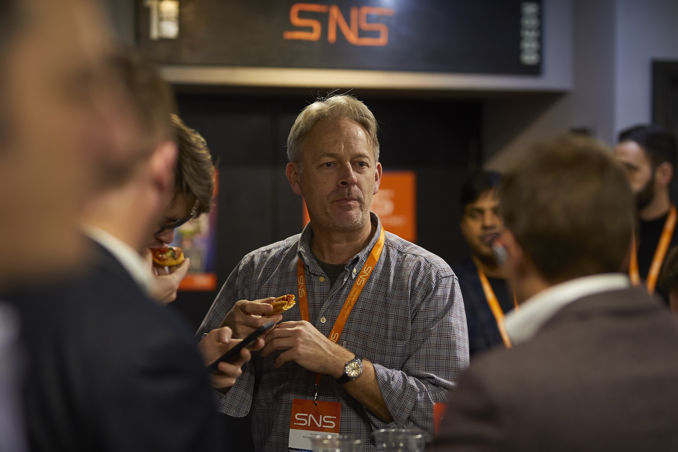 Networking and enjoying pizza at a SNS Event